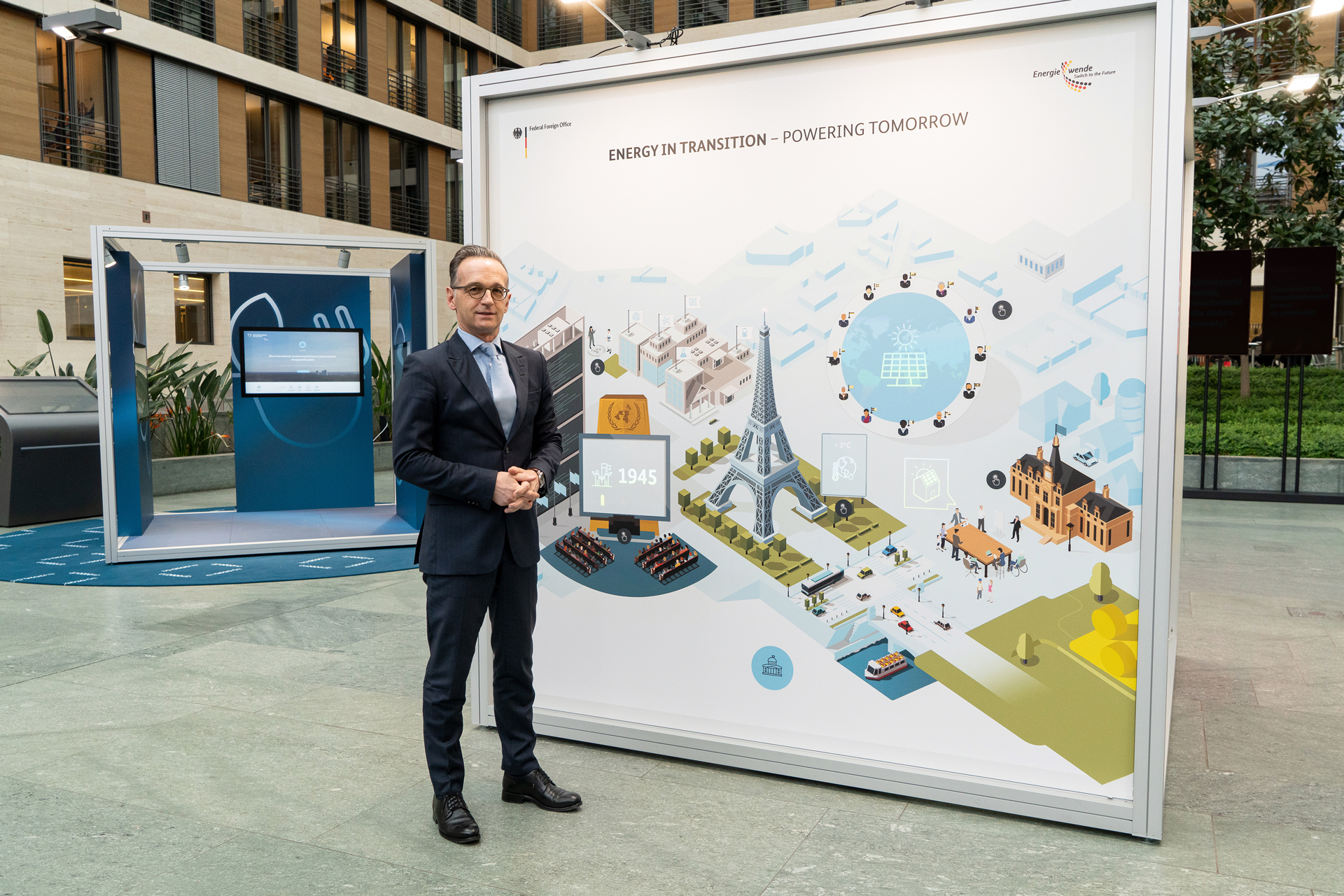 German Foreign Minister Heiko Maas visits the travelling exhibition. On the picture he is standing in front of the Energy in Transition introductory station.